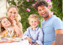 Family Enjoying Meal outdoors Royalty Free Stock Image