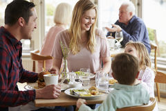 Family Enjoying Meal In Restaurant Together stock images