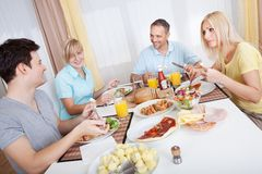 Family enjoying a meal together Stock Photography