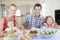 Family Enjoying Meal Together At Home Stock Images