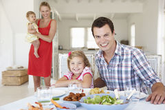 Family Enjoying Meal Together At Home Stock Photography