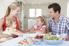 Family Enjoying Meal Together At Home Stock Image
