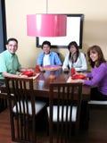 Family enjoying mealtime Royalty Free Stock Photos