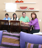 Family enjoying mealtime Stock Photos