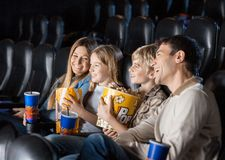 Family Enjoying Movie In Theater Stock Photo