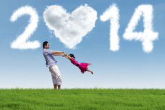 Family enjoying new year holiday in the nature Royalty Free Stock Photos