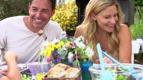 Family Enjoying Outdoor Meal In Garden stock video