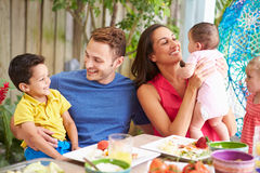 Family Enjoying Outdoor Meal At Home Royalty Free Stock Images