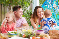 Family Enjoying Outdoor Meal At Home Royalty Free Stock Photography