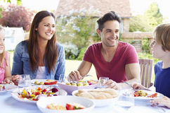 Family Enjoying Outdoor Meal Together Royalty Free Stock Photography