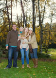 Family enjoying the Outdoors on a lovely autumn day Stock Photography