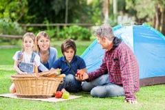 Family Enjoying Picnic At Campsite Royalty Free Stock Image