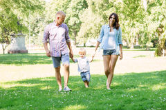 Family enjoying a picnic in the park Royalty Free Stock Images