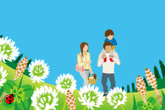 Family enjoying Picnic in Spring nature -Piggyback Royalty Free Stock Photography