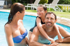 Family enjoying in pool Royalty Free Stock Images