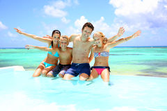 Family enjoying pool time Royalty Free Stock Images