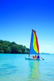 Family enjoying a ride in the sailboat Royalty Free Stock Photo