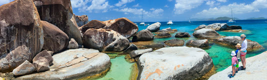 Family enjoying scenic view. Family of mother and kids enjoying view of beautiful scenery of The Baths beach area major tourist attraction at Virgin Gorda Royalty Free Stock Images