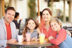 Family Enjoying Snack In CafŽ royalty free stock photos