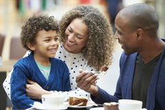 Family Enjoying Snack In CafŽ Together royalty free stock photography
