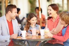 Family Enjoying Snack In CafŽ Stock Images
