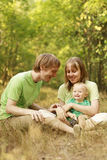 Family enjoying summer nature. Young family enjoying playing in summer nature Royalty Free Stock Photo
