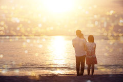 Family enjoying sunset view at coastline stock photos