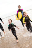 Family Enjoying the Surf Stock Photography