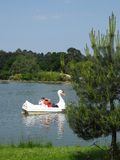 Family enjoying swan pedal boat at Woburn Safari Park, UK Stock Photos