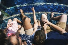 Family enjoying a swimming pool Royalty Free Stock Photo