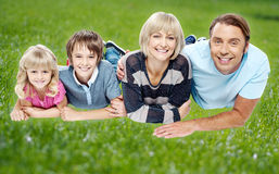 Family enjoying their day outdoors Stock Photos