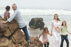 Family Enjoying Their Vacation At Beach Stock Images