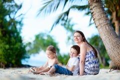 Family enjoying time at beach stock photo