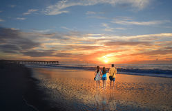 Family enjoying time together on beautiful beach at sunrise. Royalty Free Stock Photos