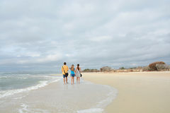 Family enjoying time together on beautiful beach, Royalty Free Stock Photos