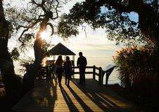 Family enjoying time together on the pier at sunset. Royalty Free Stock Images