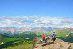Family enjoying time together on on top of the mountain. Stock Image