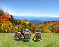 Family enjoying time on the top of mountain. Stock Photography