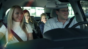 Family enjoying traveling with car through city stock footage