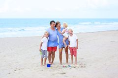 Family of 5 enjoying vacation at the sea Royalty Free Stock Image