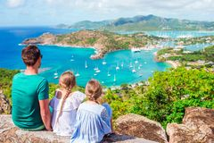 Family enjoying the view of picturesque English Harbour at Antigua in caribbean sea Stock Images