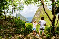 Family enjoying view of Piton mountains. Back view family of father and daughter enjoying scenery of Piton mountains on St Lucia island in Caribbean stock photos