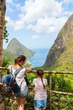 Family enjoying view of Piton mountains. Back view family of mother and daughter enjoying scenery of Piton mountains on St Lucia island in Caribbean stock image