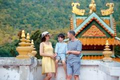 Family enjoying views of beautiful Chinese Temple on Koh Phangan island. Thailand, Asia stock images