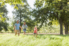 Family Enjoying Walk In Beautiful Countryside Royalty Free Stock Photos