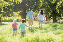 Family Enjoying Walk In Beautiful Countryside Royalty Free Stock Image