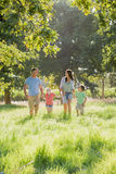 Family Enjoying Walk In Beautiful Countryside Stock Photo