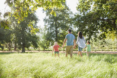Family Enjoying Walk In Beautiful Countryside Stock Images