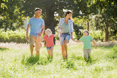 Family Enjoying Walk In Beautiful Countryside Stock Image