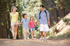 Family enjoying a walk in the countryside Stock Photos